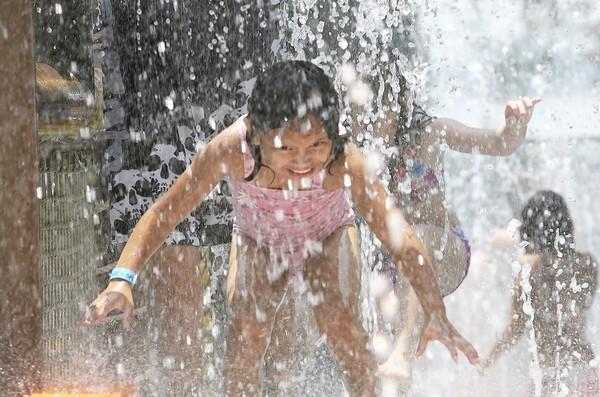 Children splash around in the water at Splash park in Tavares on Wednesday, June 15, 2011. ( Tom Benitez/Orlando Sentinel)